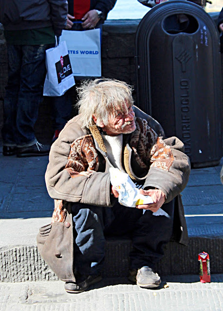 close up of tramp eating on pavement