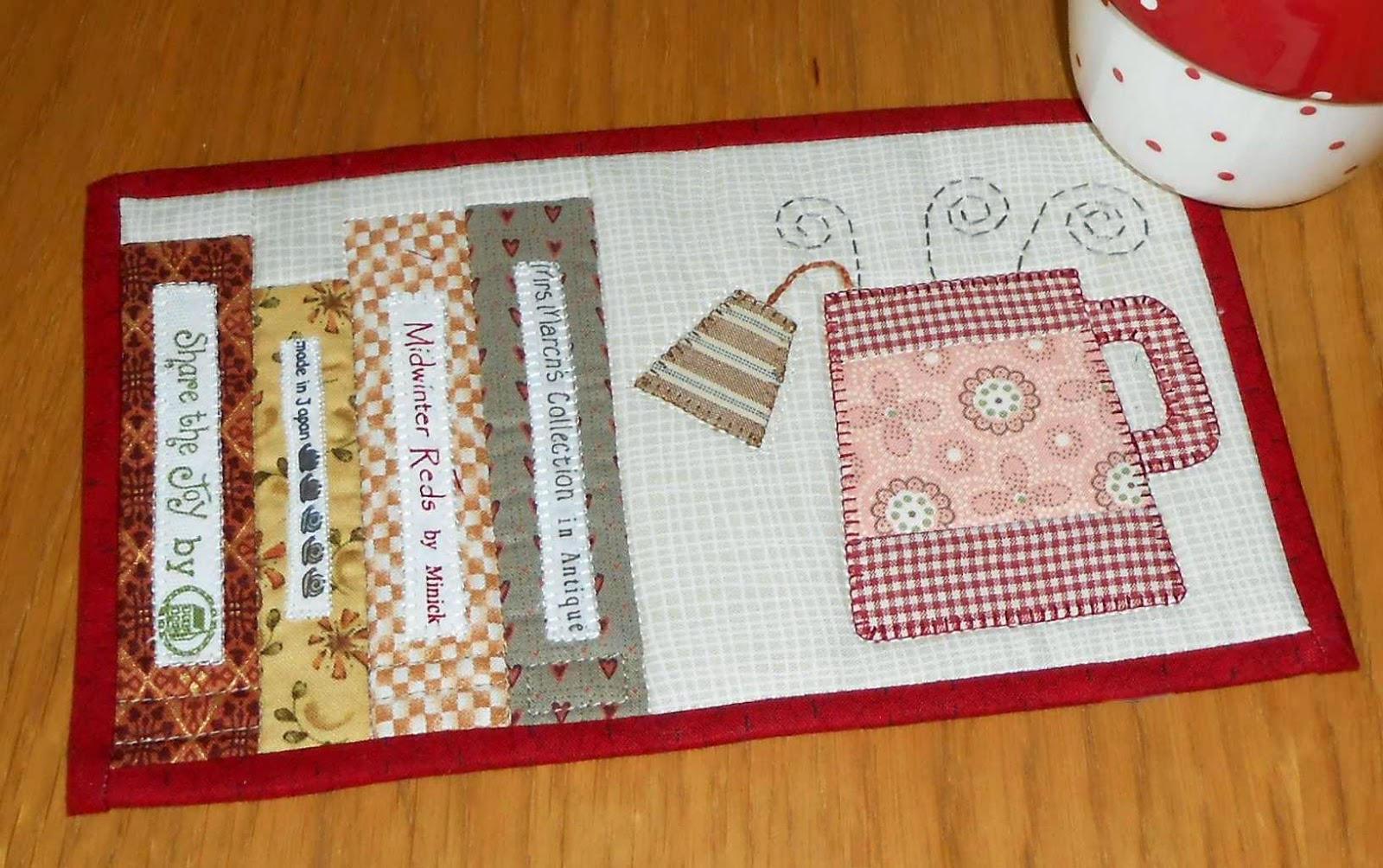http://www.craftsy.com/pattern/quilting/home-decor/tea-and-books-mug-rug/95381