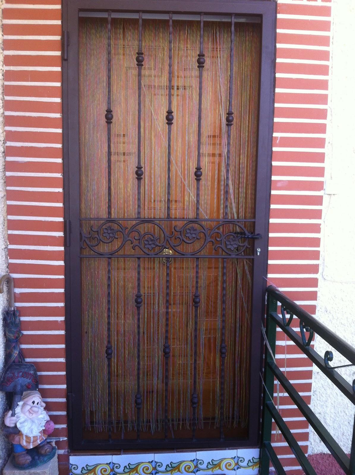 Cierres enrollables for Puertas de hierro forjado para exteriores