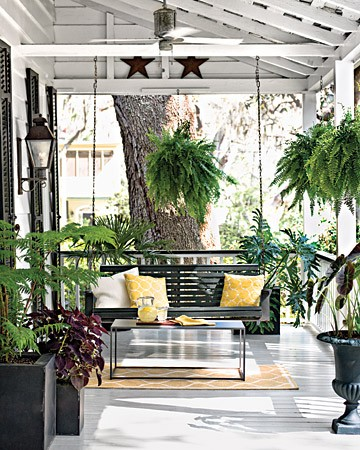 This black and white front porch decor looks modern and sleek with great pops of vibrant green