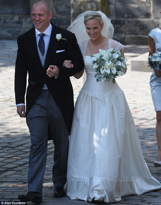 Radiant bride Zara Phillips beams as she makes her way into the ...