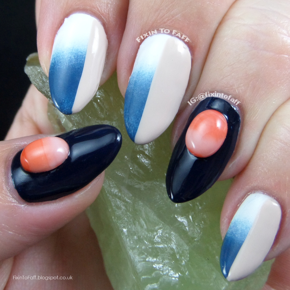 Neutral blue and white gradient colorblocking nail art inspired by fashion.