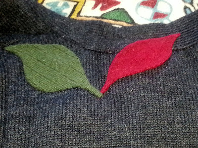 first leaves felted onto holes in my sweater