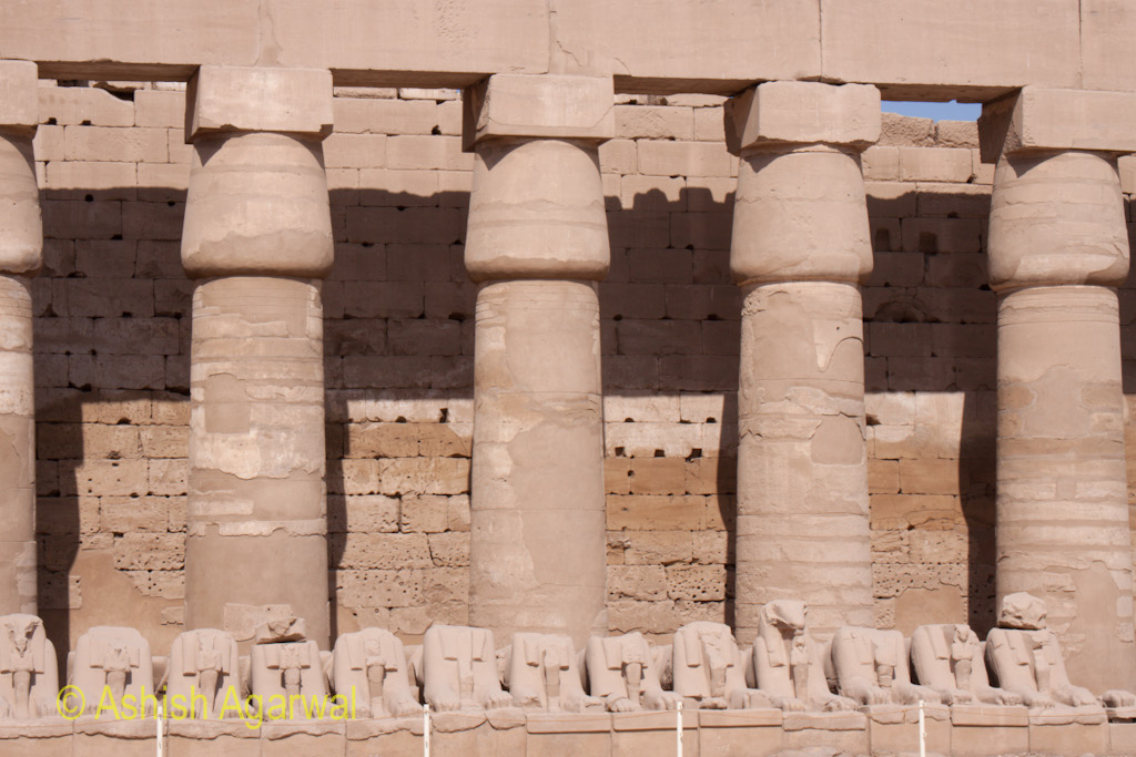Pillars inside the Karnak temple in Luxor, with a wall seemingly blocking the way