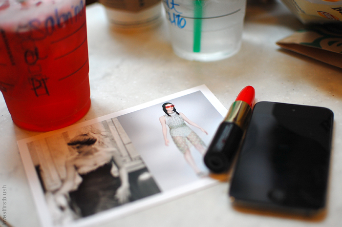lipstick pen and postcard from Prada Met museum