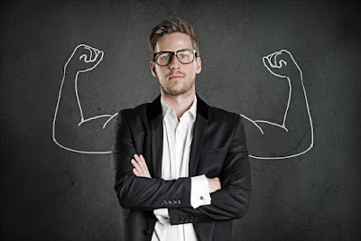 A photograph of a business man with cartoon strong arms drawn cartoon-fashion behind him