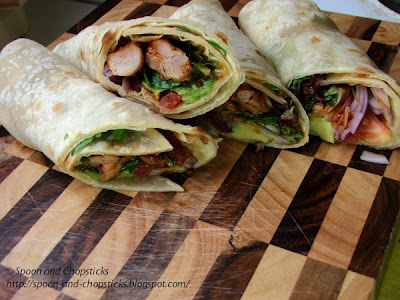 Flatbread wraps with cripsy chicken, avocado and mixed salad leaves