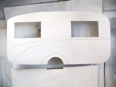 Dolls' house miniature retro caravan kit side piece, drying after being undercoated.