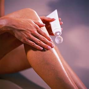 applying-lotion-after-Waxing-Hair-Removal