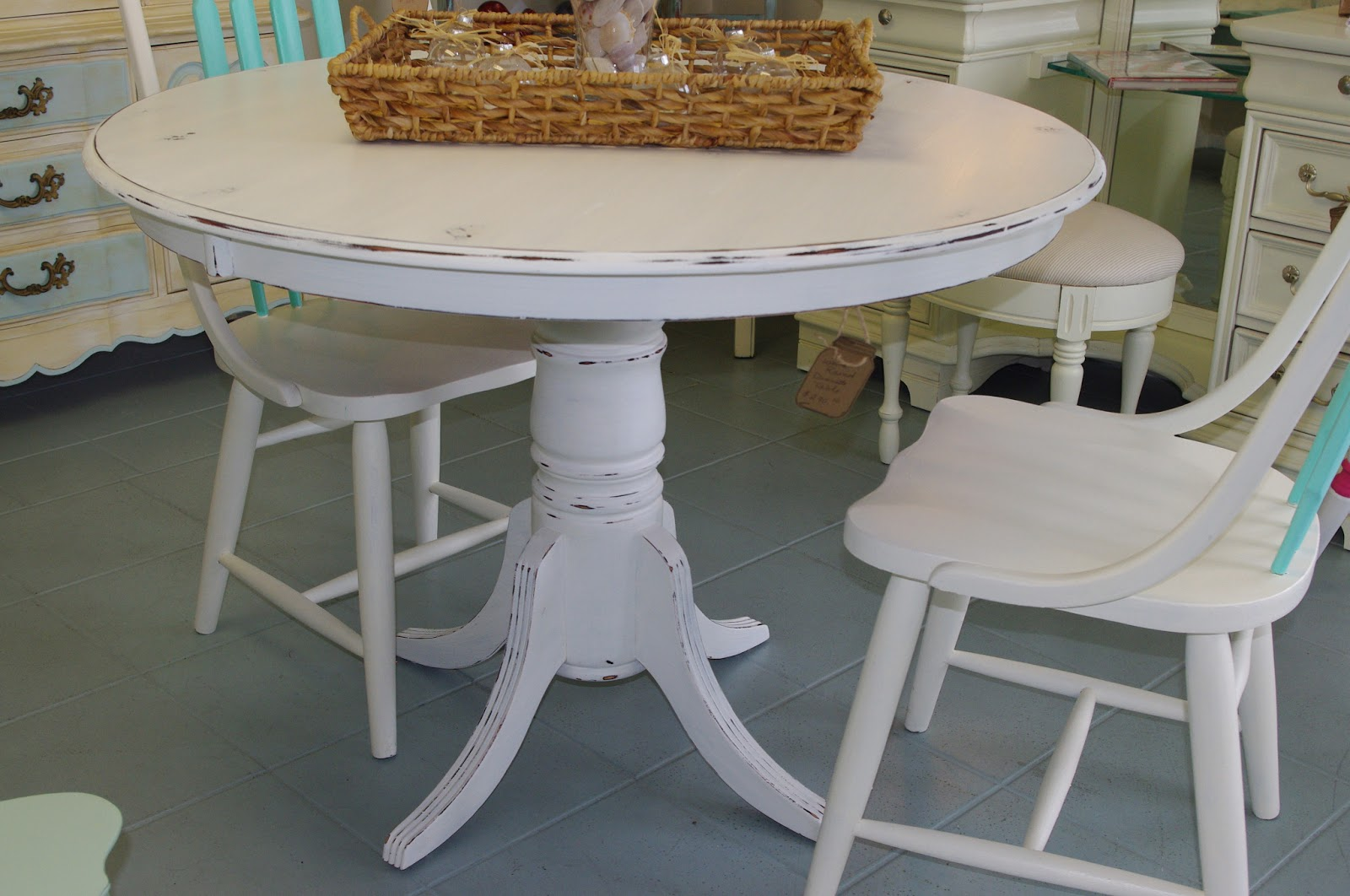 Coastal chic boutique distressed white round dining table for Distressed white dining table
