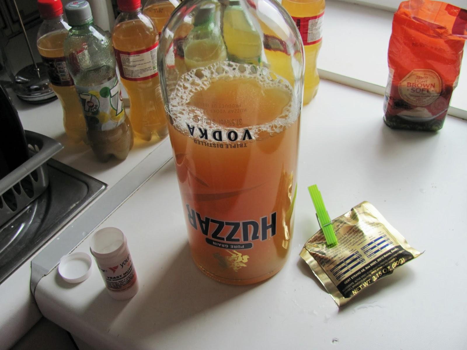 Apple juice in the empty Huzzar bottle fermenting