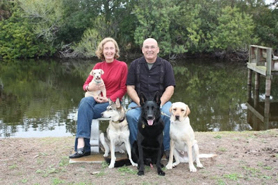 Family photo - with Toby's human family, and their other 3 dogs (Toby is on the far right)