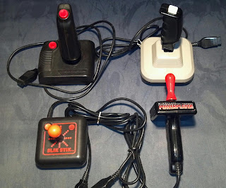 atari joysticks inlcuding an archer, a boss, a power player and slik stik