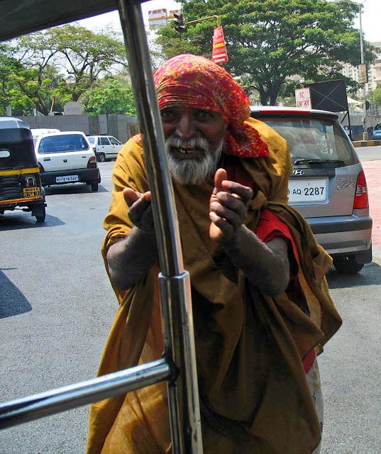 beggar running towards rickshaw