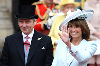 Michael and Carole Middleton smile and wave at the crowds following the marriage of Prince William, Duke of Cambridge and Catherine, Duchess of Cambridge.