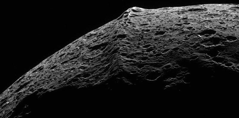 Raw image from Cassini space probe of the equatorial ridge on Saturn's moon Iapetus. Image: NASA