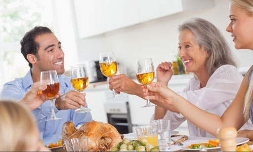 5 Tips on How to Charm her Parents,family gathering dinner eating turkey launch mother daughter man guy son