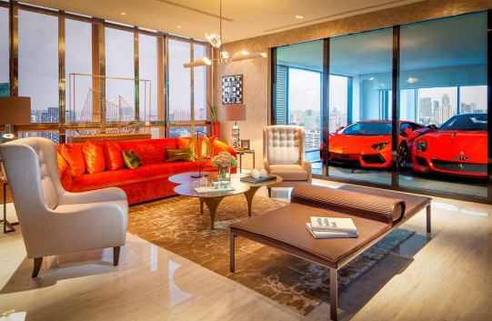 a luxury car parked inside an apartment in singapore's hamilton scott building