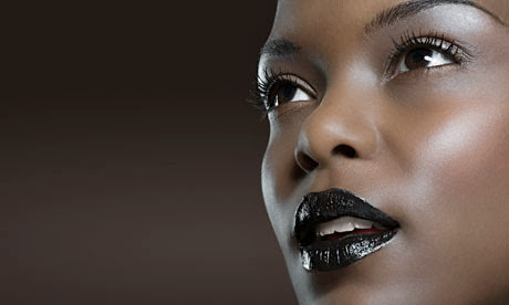 Black woman with black lipstick and grey eyeshadow