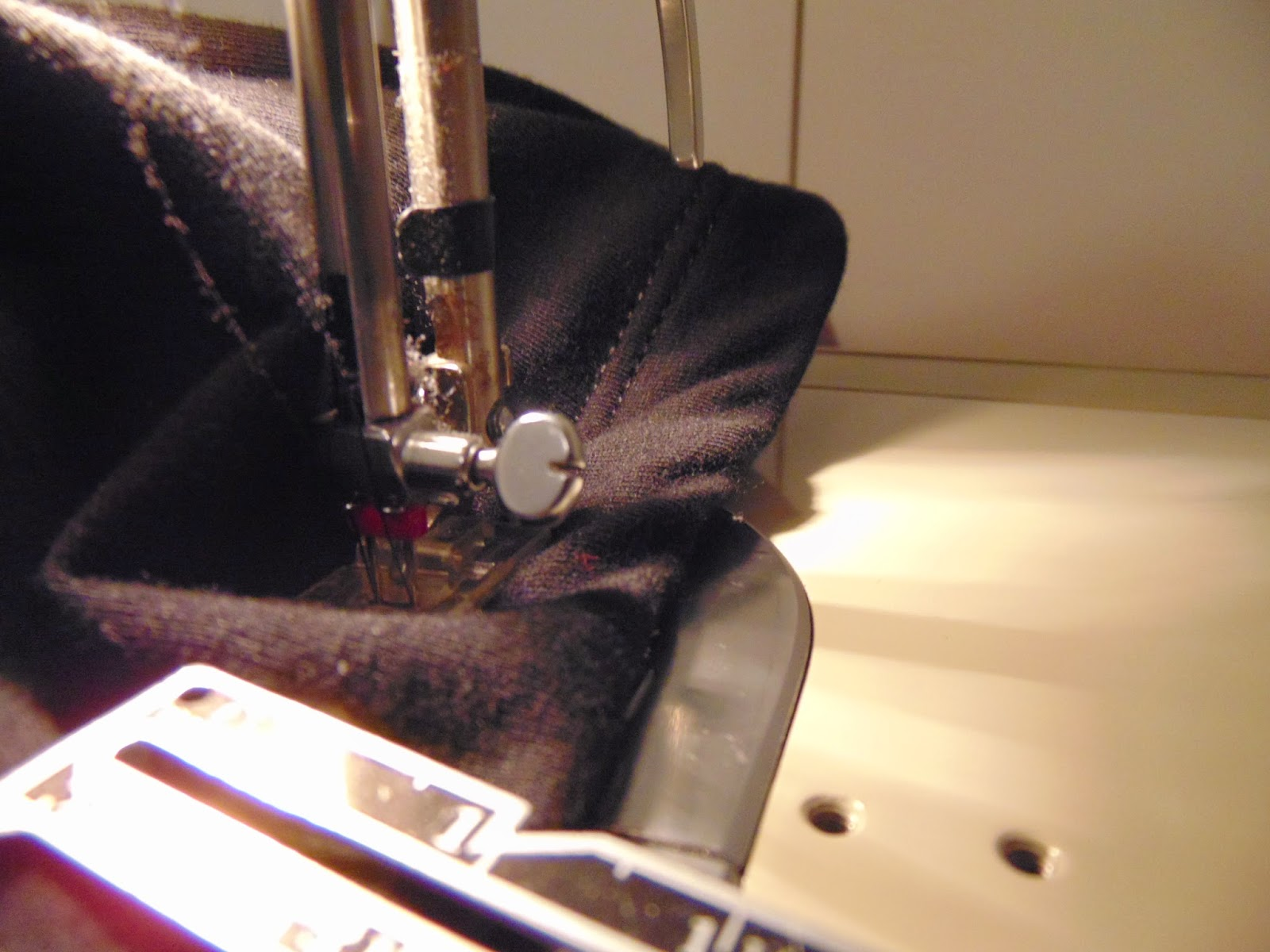 Close up of stitching in progress with double needle on knit pants