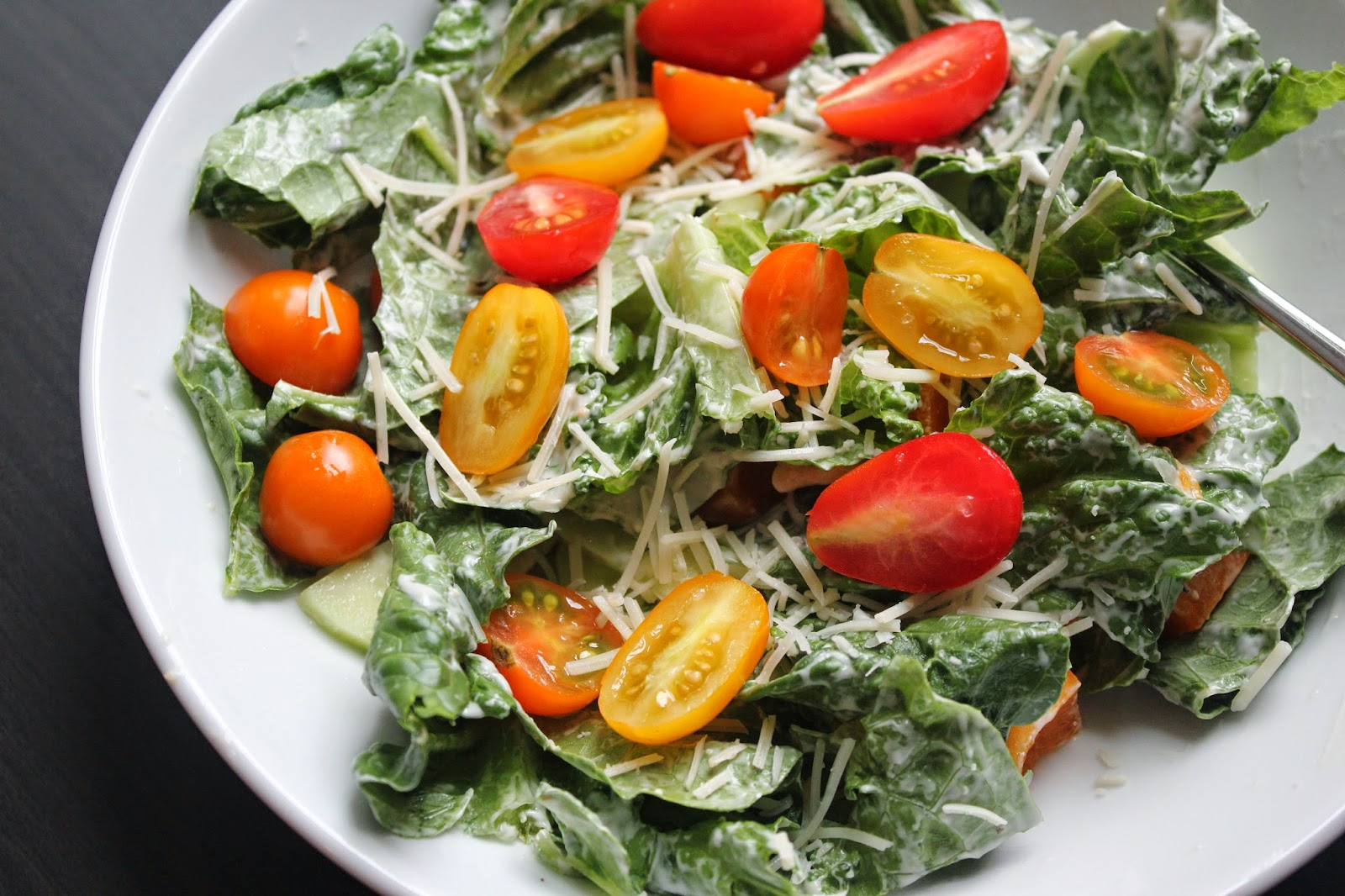 Caesar salad with tomatoes from the garden