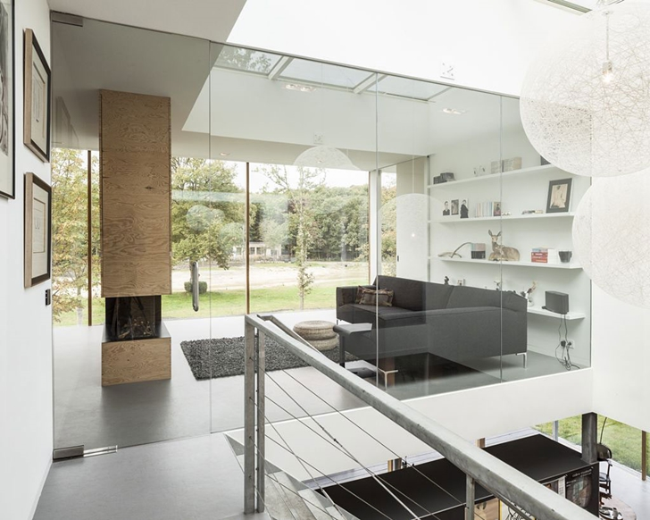 Glass wall and living room in Modern Villa V by Paul de Ruiter Architects