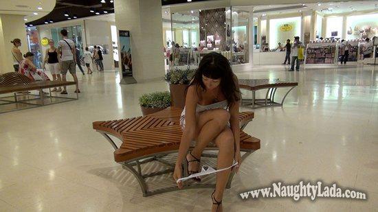 Taking off her panties in public