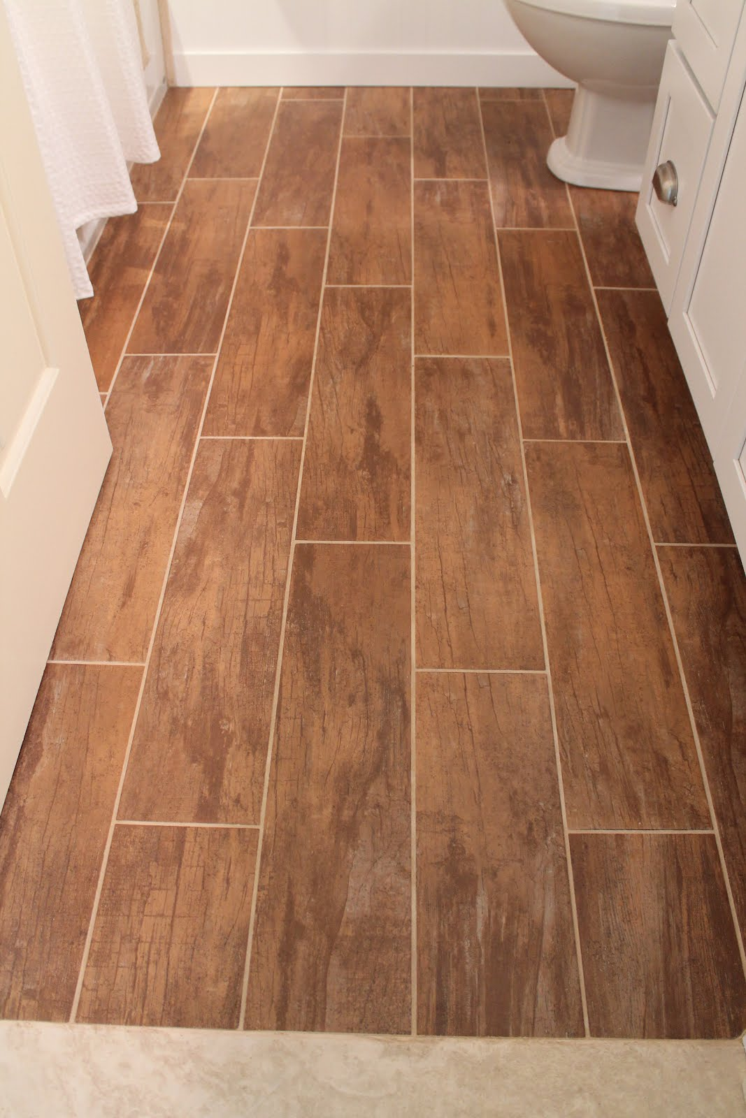Remodelaholic bathroom renovation with wood grain tile and more Tile wood floor