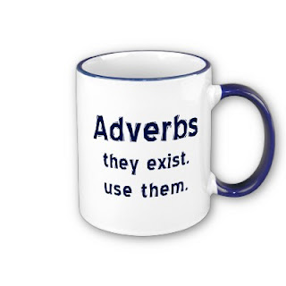 "A mug displaying the text: ""Adverbs, they exist. Use them."""