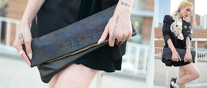 http://skinny-bags.com/?product=foldie-laser-cut-navy-leather-clutch