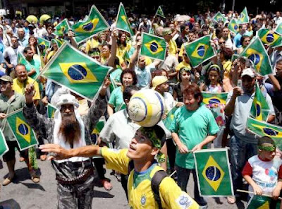 Brazil fans cheering for one of the best teams in the world cup football 2014