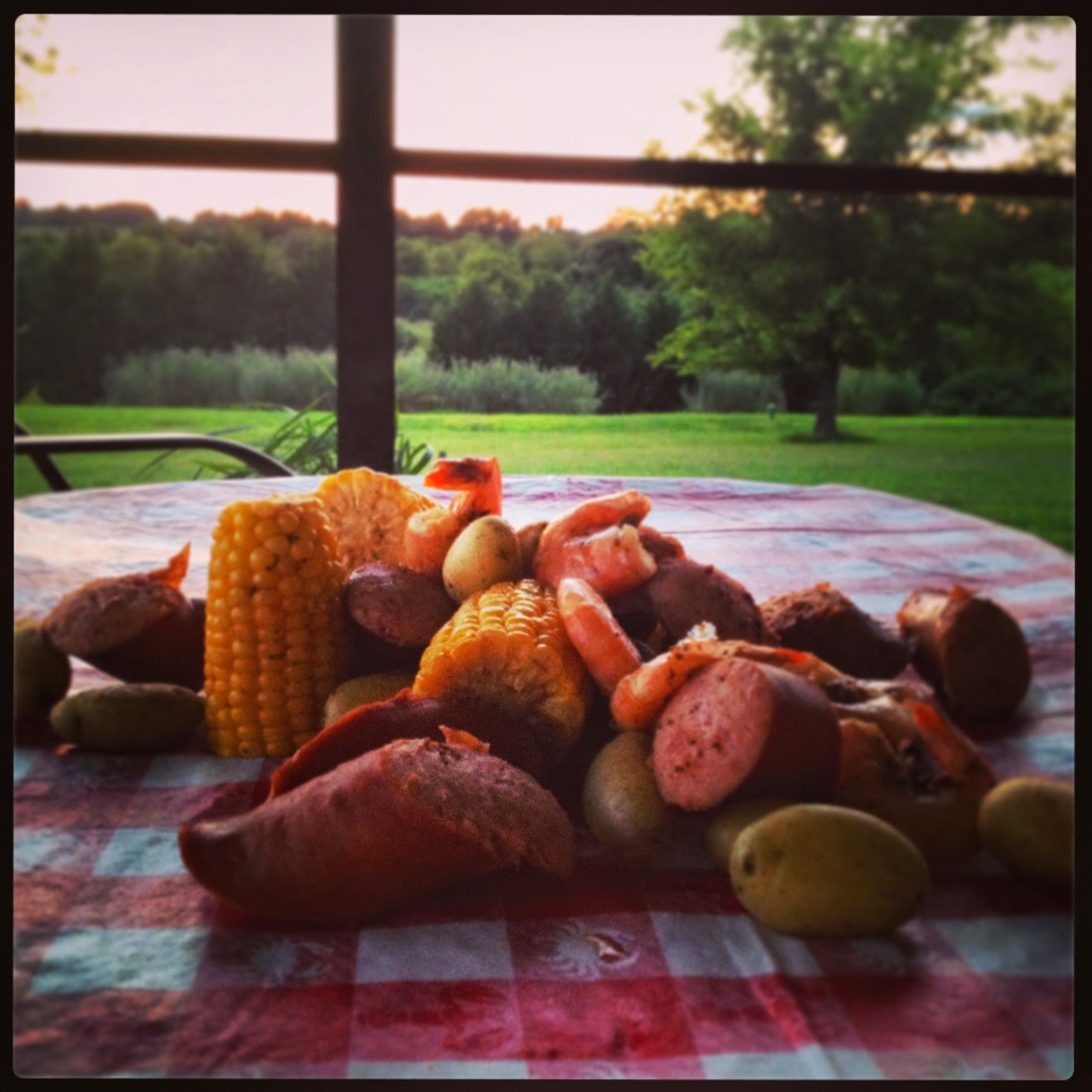 Low Country Boil  Fresh corn * smoked sausage * new potatoes * peel-on shrimp  1/2 C Old Bay * 2T sea salt * 8Q water  Boil water with seasoning.  Add potatoes. Cook 13 min.  Add corn. Cook 5 min.   Add shrimp and sausage, Cook 3-4 min.  Drain. Dump onto paper or plastic tablecloth and dig in!