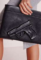 https://www.missguided.co.uk/new-in/gun-zip-top-clutch-black