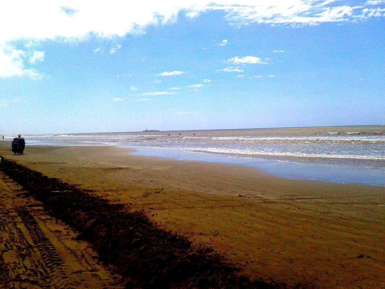 Um belo dia Na Praia do Cassino