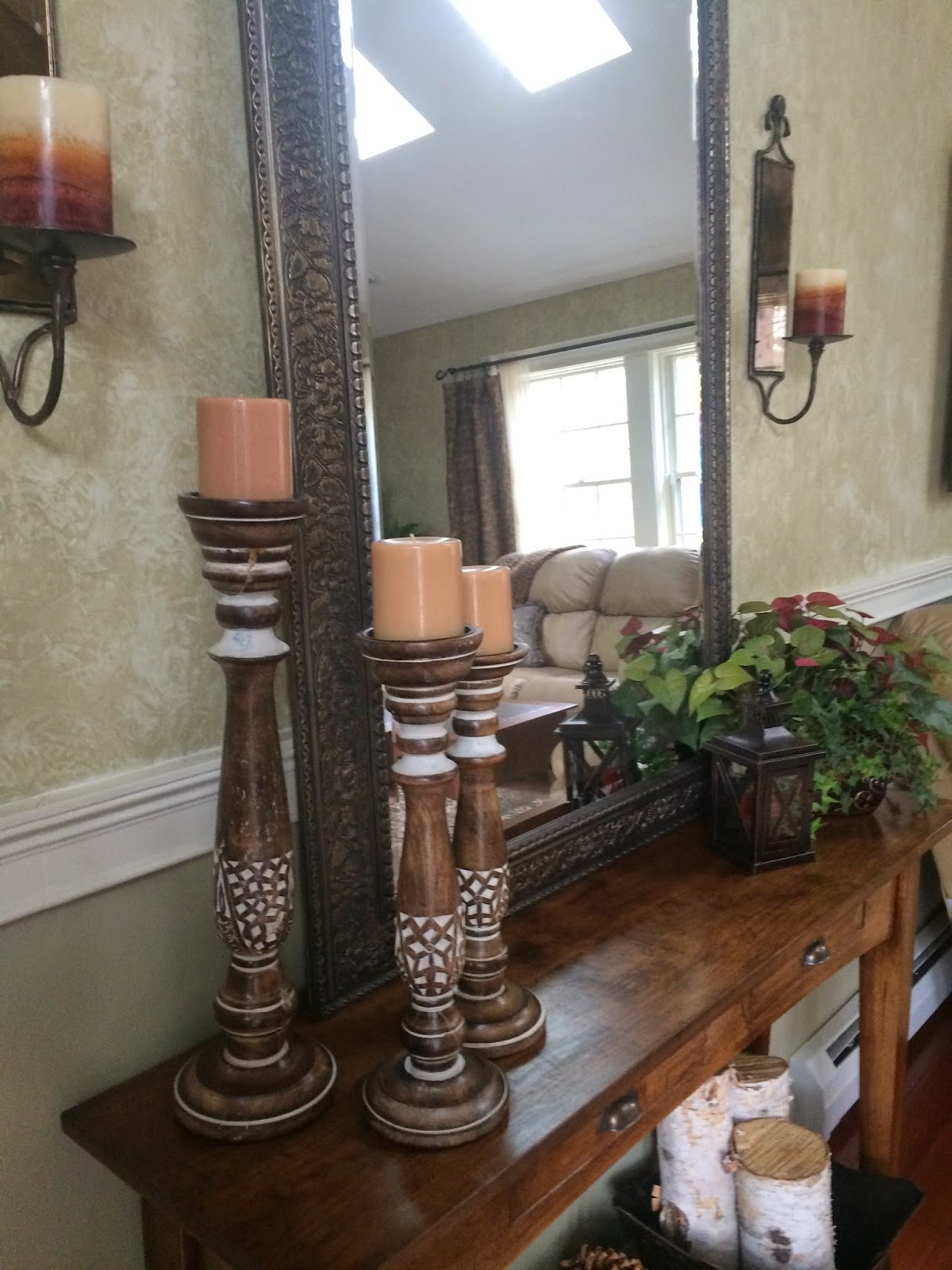how to decorate and accessorize a console table candlesticks and wall sconse