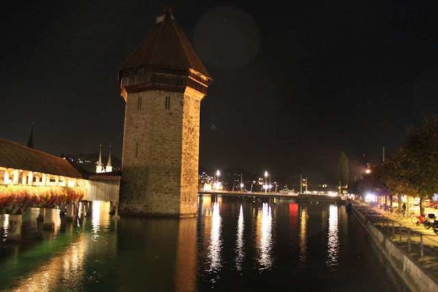 Wasserturm (water tower) litted by Chapel Bridge and its surroundings in Lucerne, Switzerland