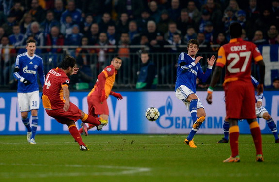 Galatasaray player Hamit Altıntop shoots to score his team's first goal against Schalke