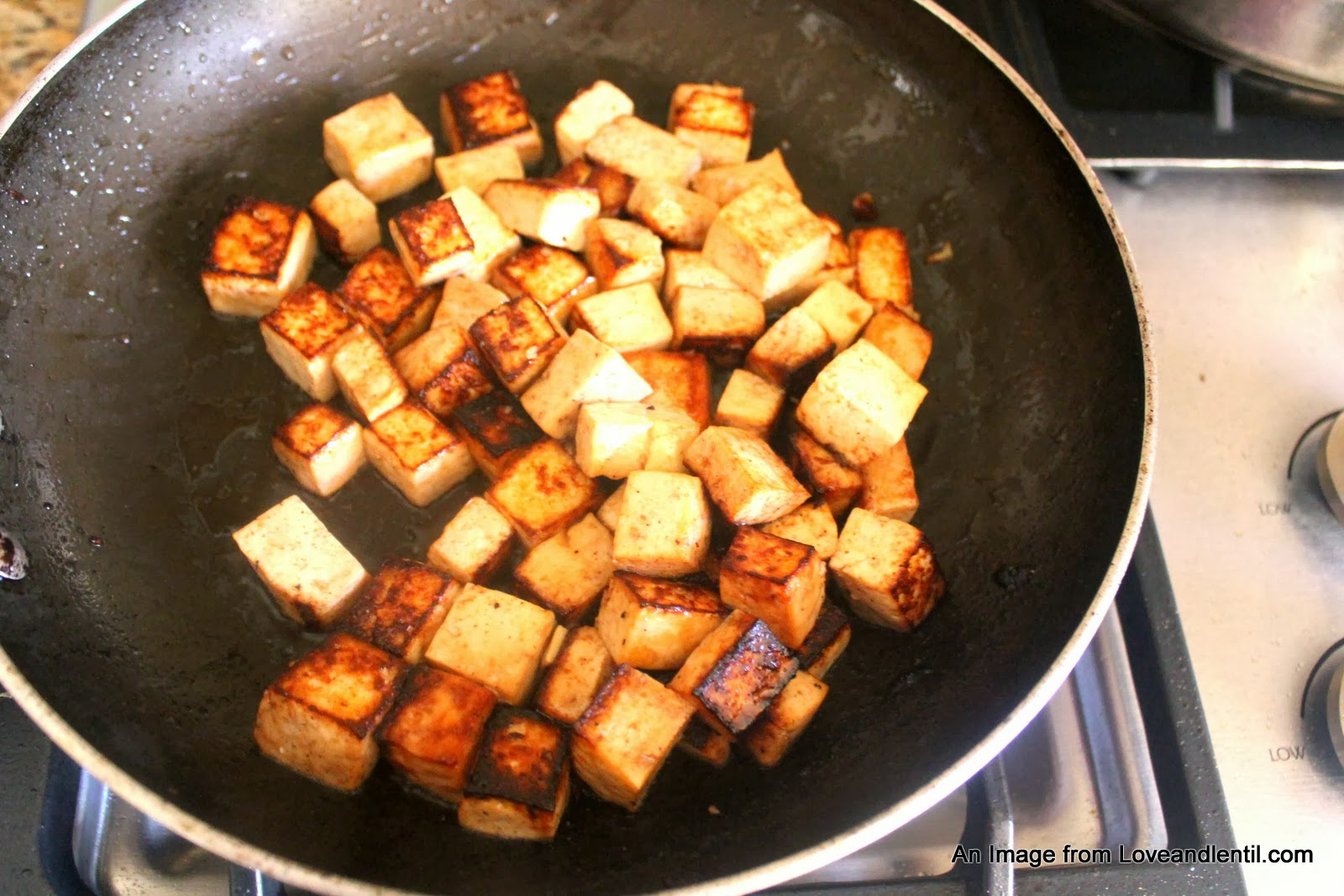Add the tofu to the veggies and stir in well.
