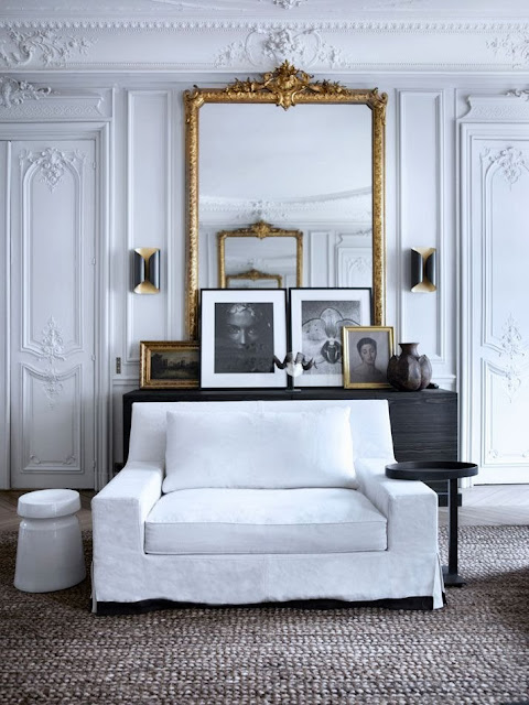 neutral living room with gold accents white walls and furniture