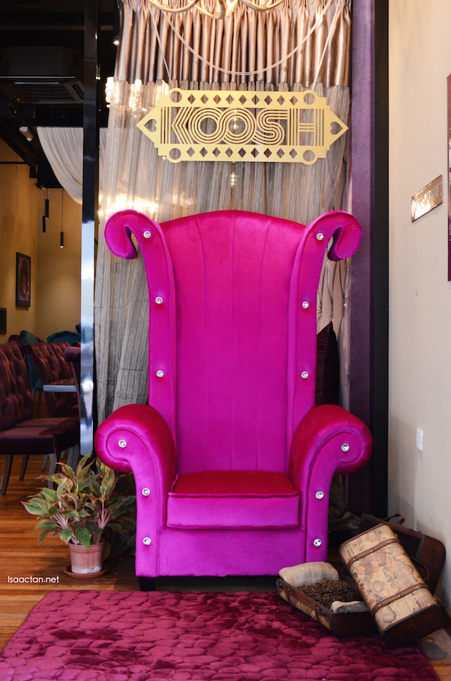 The signature plush purple chair at the front #KooshKoffeez