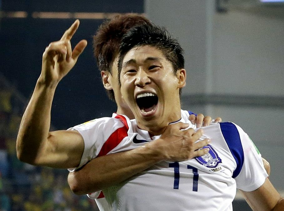 South Korea's Lee Keun-ho celebrates after scoring the opening goal during the group H World Cup soccer match between Russia and South Korea at the Arena Pantanal in Cuiaba, Brazil, Tuesday, June 17, 2014.