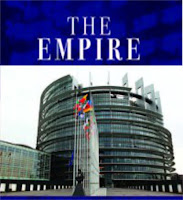 a graphic (c) Erika Grey titled The Empire representing the EU Empire, in which the Empire is written in capital letters in white across a blue background and below in the European Union's Parliament building.