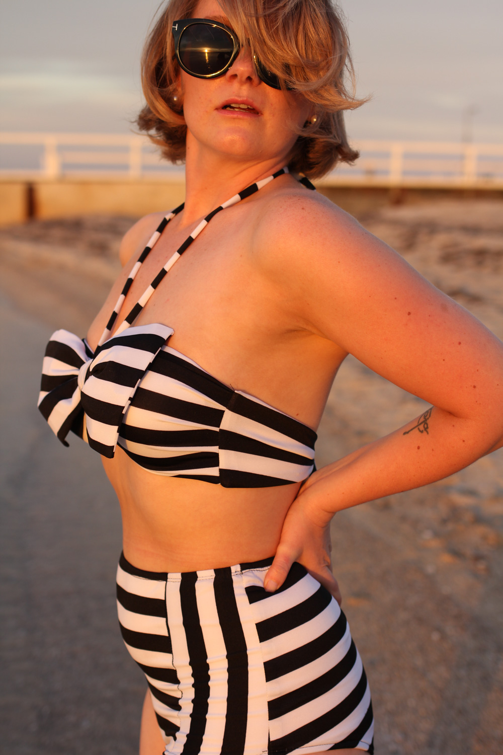 @findingfemme wears striped Bikiniboo high waisted bikini at the beach.