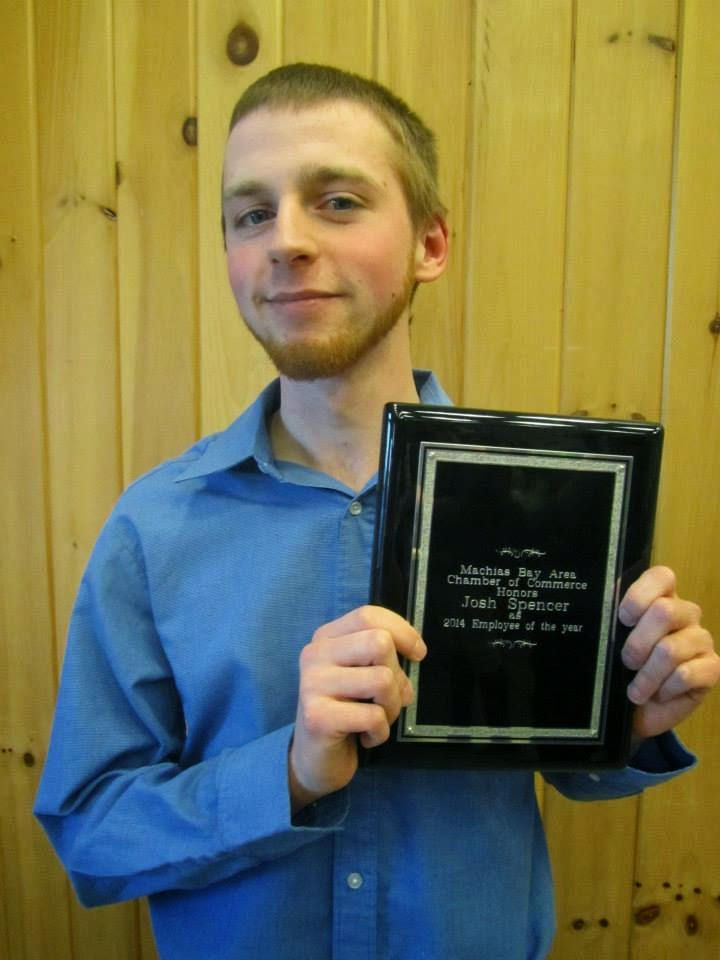 Josh displaying plaque recognizing him as Machias' Chamber of Commerce 2014 Employee of the Year