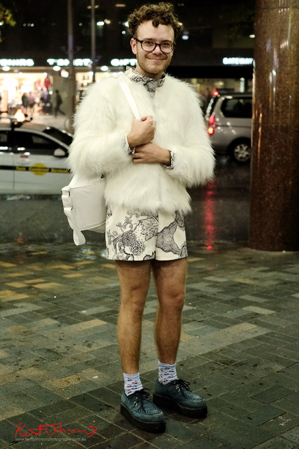 Street Style, Man at Circular Quay Sydney, White Faux Fur and shorts and bag.