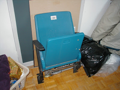Grandstand seat from Exhibition Stadium in Toronto. Chair used to be bolted to concrete.