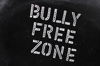 Bully Free Zone written in chalk on a blackboard