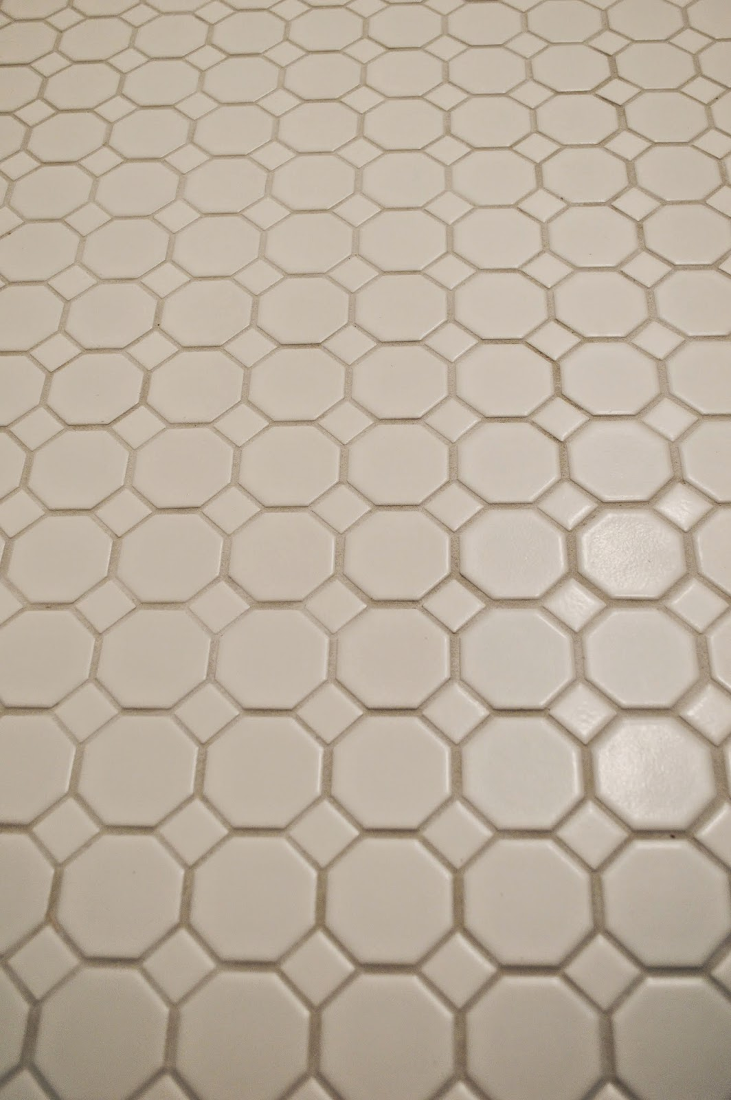 724 south house my new bathroom obsession the floor tile the gray contrasting with the white tile really shows off and compliments the design and i dont have to worry about dirt getting in the grout lines dailygadgetfo Gallery