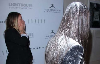 Kim Kardashian walks away after getting flour bombed