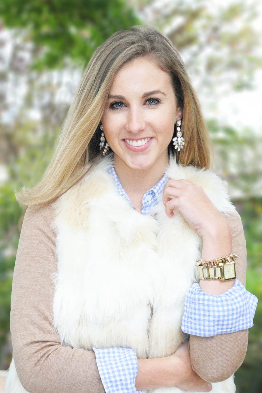 the-perfect-winter-headshot-fur-vest-with-statement-earrings-and-layers